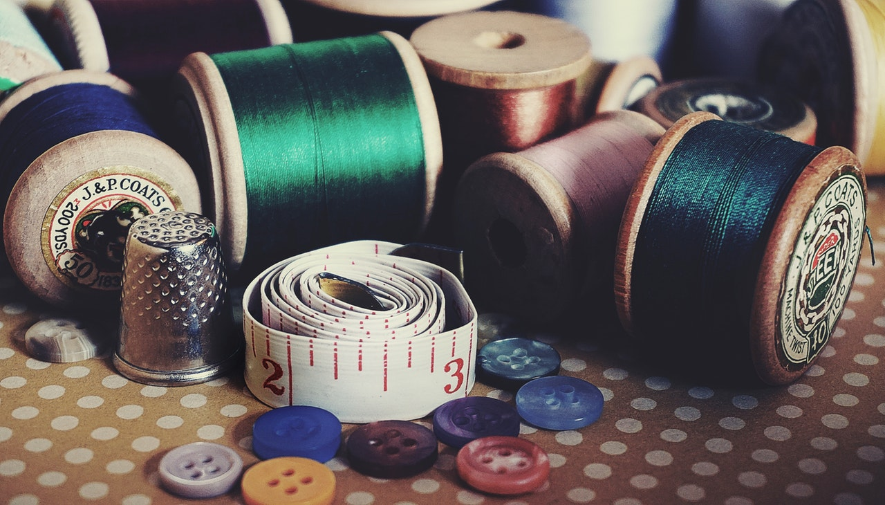 different thread, assorted colored button, thimble and other things needed for quilting